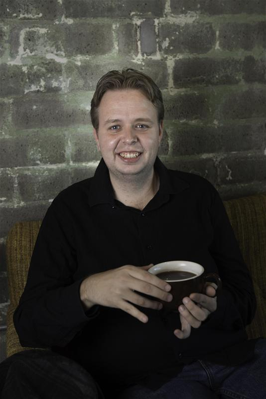 Justin Babb Portrait Drinking Coffee